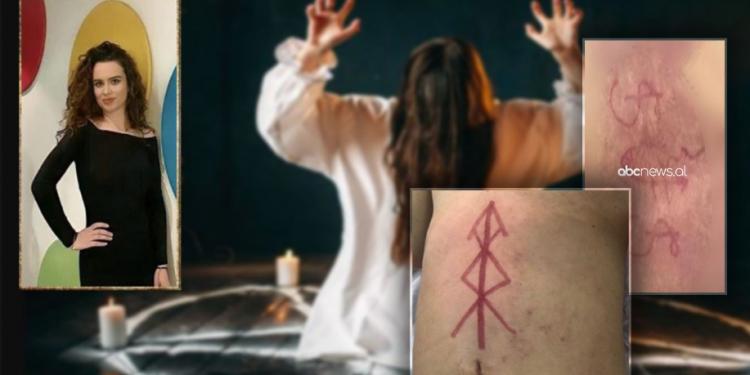Vdekja e 23-vjeçares/Simboli në bark, dashurinë mes 2 femrave. Ngjyra nënkupton djallin dhe Luciferin